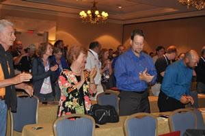 Attendees applaud keynote Jim Abbott's speech at Auto Glass Week 2013.