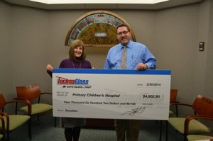 Techna Glass' Troy Mason presents a check to the Children's Primary Hospital.