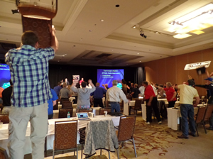 Gary Michaels of Southwestern Consulting gets Novus Franchisees to show their enthusiasm for their work during the Novus Super Session Franchisee meeting held in Tucson, Ariz., late last week.