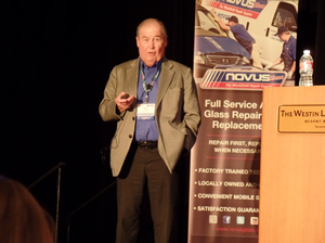 Father Allan and son Garry Skidmore, chairman/CEO and president/COO, respectively, address franchisees at the Novus Super Session in Tucson, Ariz., today.