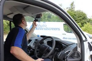 An Auto Windscreens' technician with a SmartWitness camera.