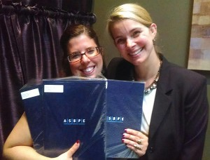 AGRR magazine and glassBYTEs.com editor Jenna Reed and vice president of media services' Holly Biller accept the regional Azbee awards in Arlington, Va., this week.