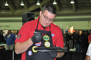 Chris Smith, gold-place winner in the 2014 GlasWeld Windshield Repair Olympics in Honor of Walt Gorman.