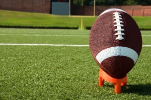 Football on Stand Facing Field Goal