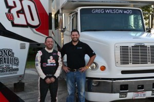Sprint Car racer Greg Wilson (left) and Jared Benson, program manager for Guardian's Custom Glass Solutions, (right) in front of the new windshield embedded with LEDs.