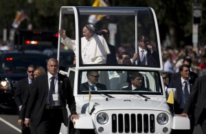 Pope Francis waves from his popemobile during a parade around the Ellipse near the White House in Washington, Wednesday, Sept. 23, 2015. (AP Photo/Carolyn Kaster)