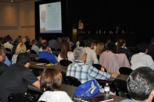 Amber Joy Fiedler teaches a packed house of business owners how to market to the Millennial generation.