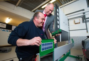 Tim Camm, technical manager, trains a National Windscreens technician on calibration.