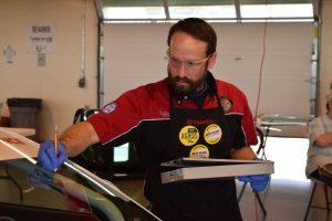 Jon Barney wins the TechnaGlass repair competition.