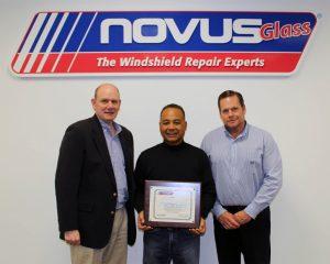 Left to right: Keith Beveridge, senior vice president of Novus; Frank Aguero, new franchisee; and Scott Rethwill, regional manager for Novus.