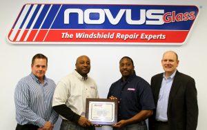 Left to right: Scott Rethwill, central regional director of Novus; Lorenzo and Lynn Washington, the new Novus franchisees; and Keith Beveridge, senior vice president of Novus.
