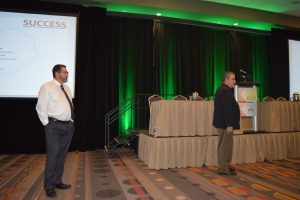 Troy Mason (left) of TechnaGlass and David Leach of Don's Mobile Glass/Wardrobe and Bath Specialties deliver a presentation at Auto Glass Week October 6 in San Antonio, Texas.