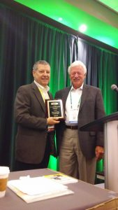 David Rohlfing accepts the AGSC award presented by Carl Tompkins.